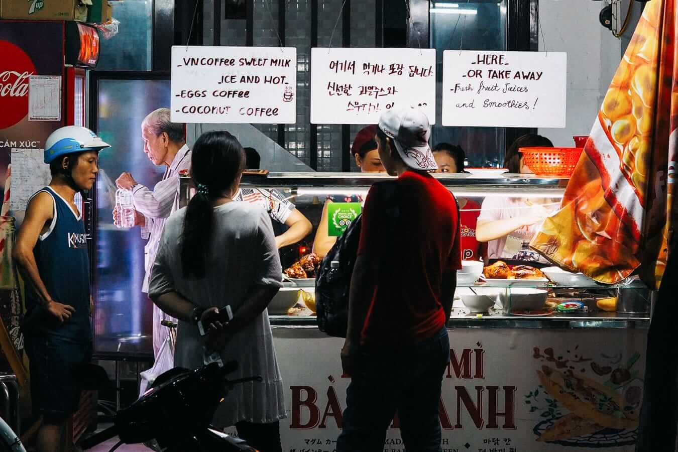 Buyers wait for their banh mi: best banh mi hoi an