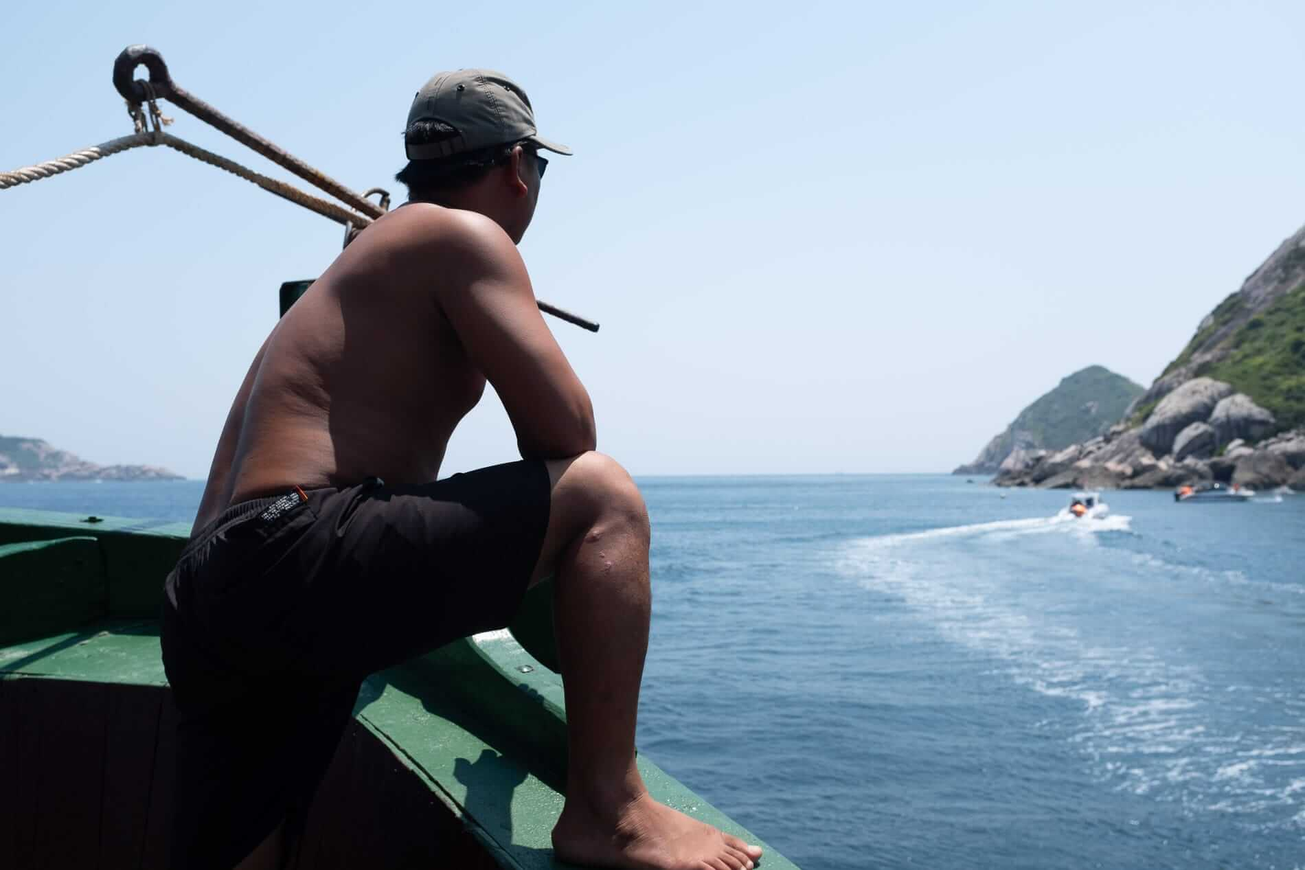 A crewman on the diving boat - Cham Island Accommodation